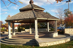 A gazebo on an ornate stone platform.