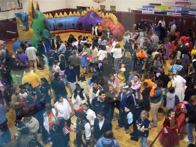 A crowded, Halloween-themed gymnasium.