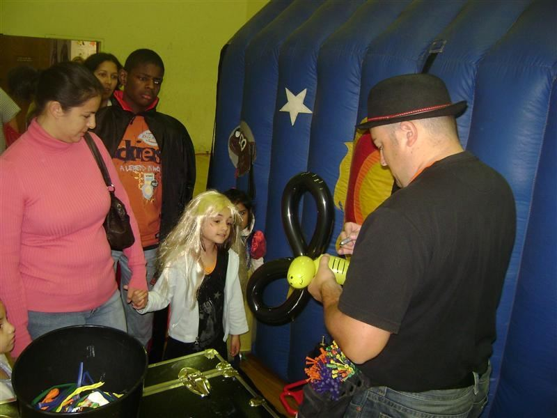 A man making balloon animals for onlookers.