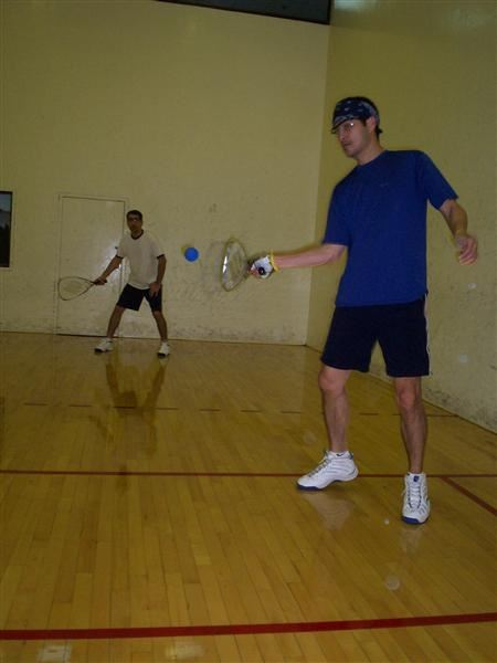 A pair of men playing racquetball.