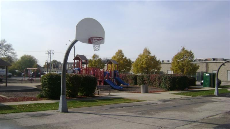 A basketball goal with trees in the background.