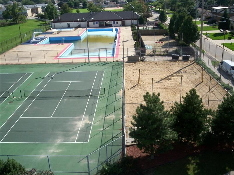 Overhead view of a tennis court near the water park.
